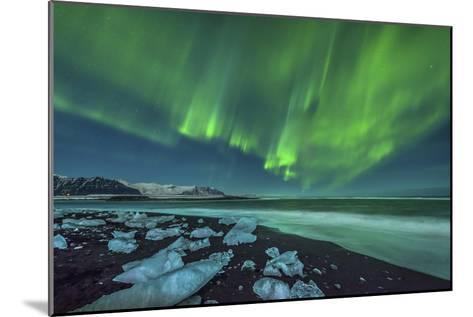 Aurora Borealis over the Ice Beach Near Jokulsarlon, Iceland--Mounted Photographic Print
