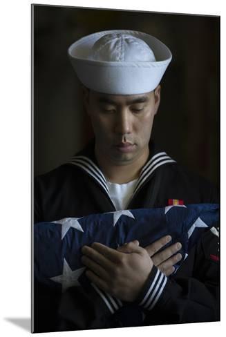Damage Controlman Bears the American Flag--Mounted Photographic Print