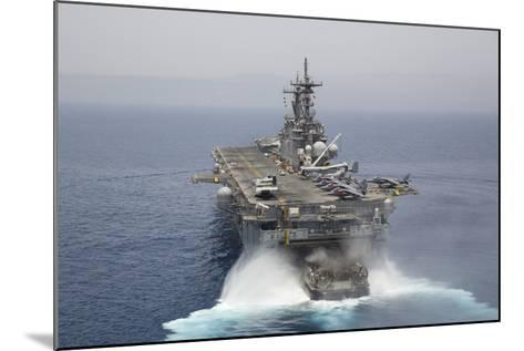 A Landing Craft Air Cushion Enters the Well Deck of USS Kearsarge--Mounted Photographic Print