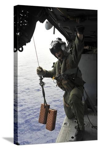 Naval Aircrewman Conducts a Search and Rescue Drill on an Mh-60S Sea Hawk--Stretched Canvas Print