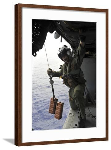 Naval Aircrewman Conducts a Search and Rescue Drill on an Mh-60S Sea Hawk--Framed Art Print