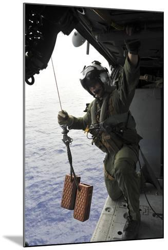 Naval Aircrewman Conducts a Search and Rescue Drill on an Mh-60S Sea Hawk--Mounted Photographic Print