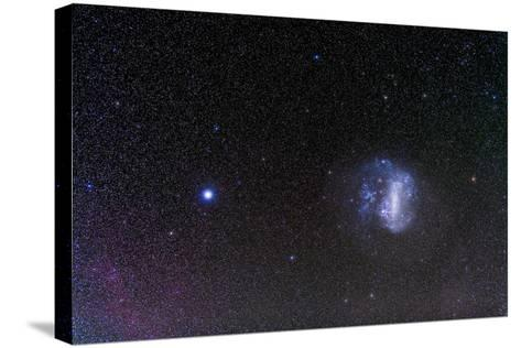The Large Magellanic Cloud and Bright Star Canopus--Stretched Canvas Print