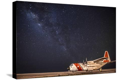 A U.S. Coast Guard C-130 Hercules Parked on the Tarmac on a Starry Night--Stretched Canvas Print