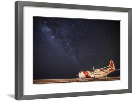A U.S. Coast Guard C-130 Hercules Parked on the Tarmac on a Starry Night--Framed Art Print