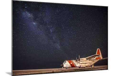 A U.S. Coast Guard C-130 Hercules Parked on the Tarmac on a Starry Night--Mounted Photographic Print