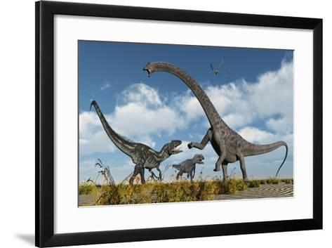 A Pair of Allosaurus Dinosaurs Confront a Giant Diplodocus--Framed Art Print