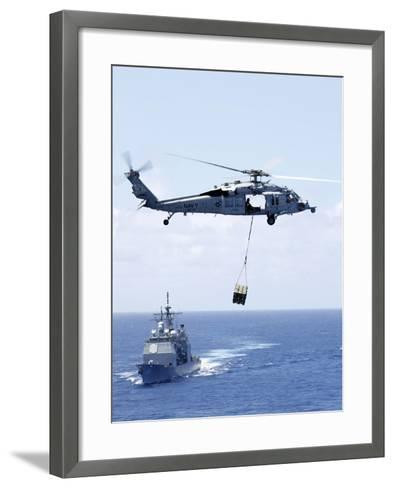 An Mh-60S Sea Hawk Helicopter Flying in Front of USS Gettysburg--Framed Art Print