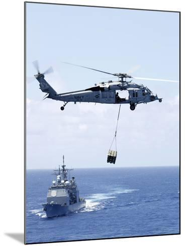 An Mh-60S Sea Hawk Helicopter Flying in Front of USS Gettysburg--Mounted Photographic Print