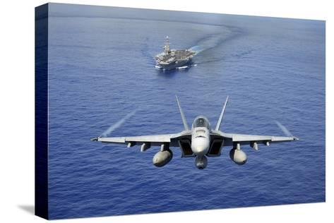 An F-A-18E Super Hornet Flying Above USS John C. Stennis--Stretched Canvas Print