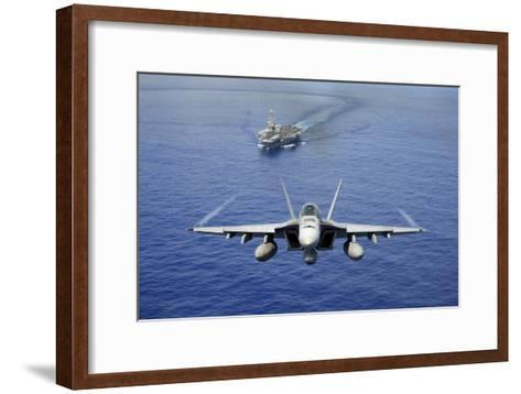 An F-A-18E Super Hornet Flying Above USS John C. Stennis--Framed Art Print