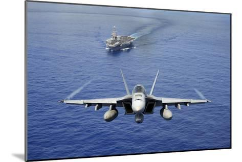 An F-A-18E Super Hornet Flying Above USS John C. Stennis--Mounted Photographic Print