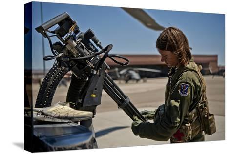 Airman Examines the Barrels of a Gau-2 Mini Gun on an Hh-60 Pave Hawk--Stretched Canvas Print