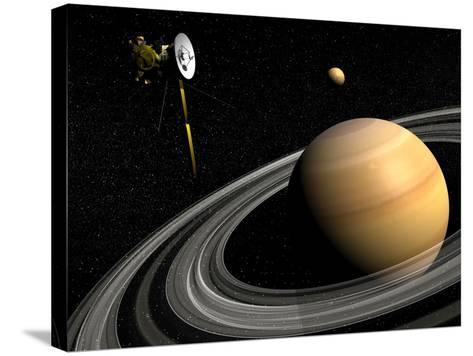 Cassini Spacecraft Orbiting Saturn and And its Moon Titan--Stretched Canvas Print