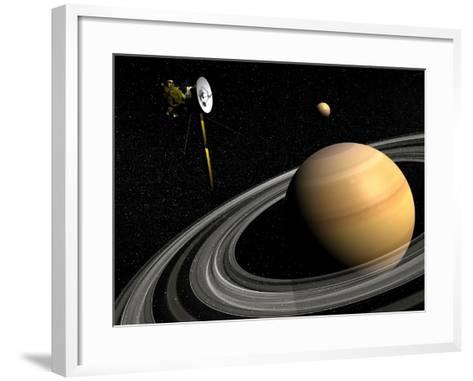 Cassini Spacecraft Orbiting Saturn and And its Moon Titan--Framed Art Print