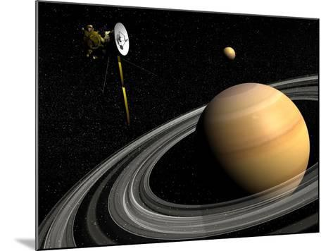 Cassini Spacecraft Orbiting Saturn and And its Moon Titan--Mounted Art Print