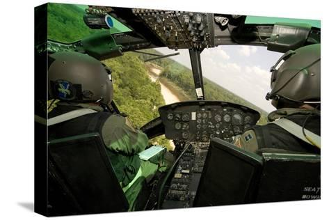 Two Instructor Pilots Practice Low Flying Operations in a Uh-1H Huey Helicopter--Stretched Canvas Print