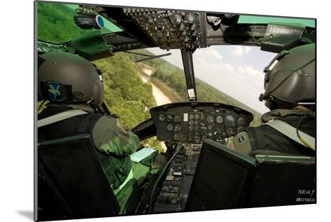 Two Instructor Pilots Practice Low Flying Operations in a Uh-1H Huey Helicopter--Mounted Photographic Print