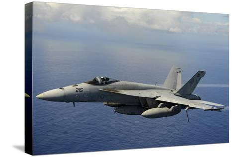 An F-A-18E Super Hornet over the Pacific Ocean--Stretched Canvas Print