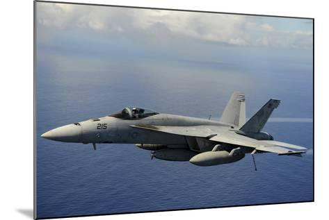 An F-A-18E Super Hornet over the Pacific Ocean--Mounted Photographic Print