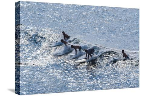 Surfers at the Hookipa Beach Park, Paai, Maui, Hawaii, United States of America, Pacific-Michael Runkel-Stretched Canvas Print