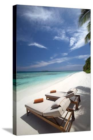 Lounge Chairs on Tropical Beach, Maldives, Indian Ocean, Asia-Sakis Papadopoulos-Stretched Canvas Print