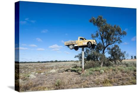 Old Truck on a Huge Pole-Michael Runkel-Stretched Canvas Print