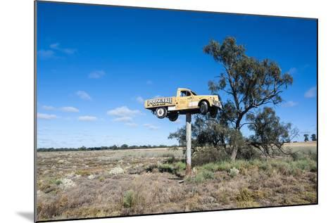 Old Truck on a Huge Pole-Michael Runkel-Mounted Photographic Print