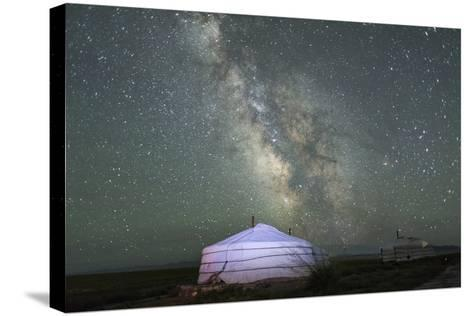 The Milky Way Rises over a Mongolian Ger in South Gobi Desert, Mongolia-Ira Block-Stretched Canvas Print