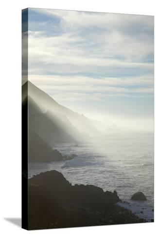 Early Morning Fog Lifts Off the Pacific Ocean Along the Big Sur Coastline-Macduff Everton-Stretched Canvas Print