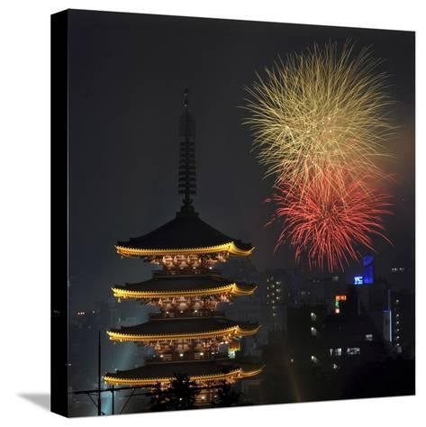 Fireworks Explode over the Five-Storypagoda of Sensoji Temple at Asakusa, Downtown in Tokyo, Japan-Kimimasa Mayama-Stretched Canvas Print