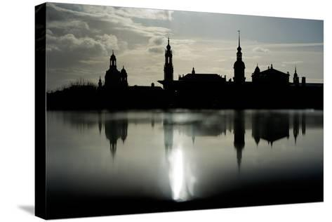 The Skyline Is Reflected on a Rainy Day in Dresden, Germany-Arno Burgi-Stretched Canvas Print