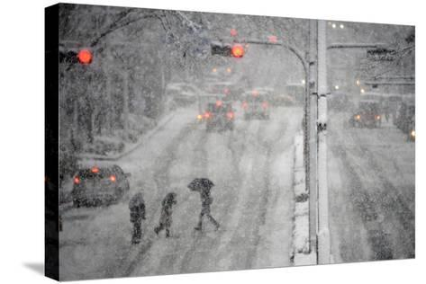 Pedestrians Cross a Large Avenue as Heavy Snow Falls in Tokyo-Franck Robichon-Stretched Canvas Print