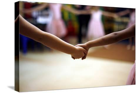 Two Girls Hold Hands-Kim Ludbrook-Stretched Canvas Print