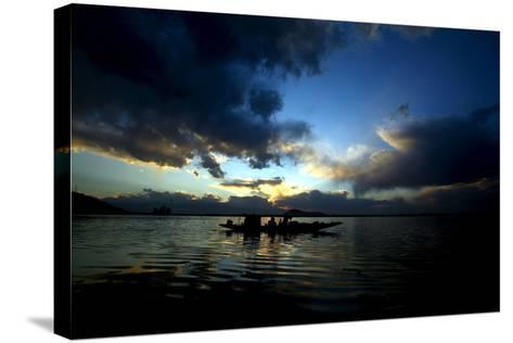 A Kashmiri Fisherman Rows His Boat on Dal Lake in Srinagar, the Summer Capital of Indian Kashmir-Farooq Khan-Stretched Canvas Print