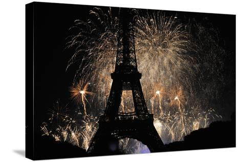 Fireworks Illuminate the Sky at the Eiffel Tower in Paris-Yoan Valat-Stretched Canvas Print