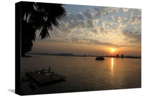 The Sun Rises Behind the Nile River in Juba, Southern Sudan-Mohamed Messara-Stretched Canvas Print