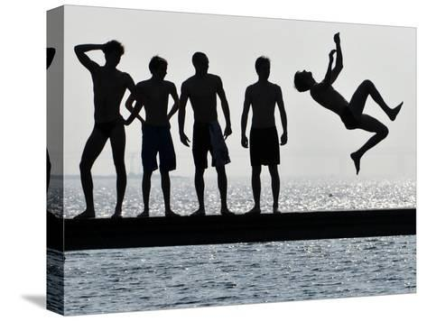 Boys Jumps into the Water on the First Sunny Spring Day in Malmo-Johan Nilsson-Stretched Canvas Print
