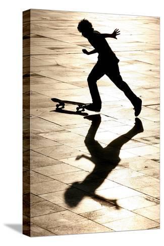 A Skateboarder Takes Advantage of a Sunny and Warm Day-Andrzej Grygiel-Stretched Canvas Print