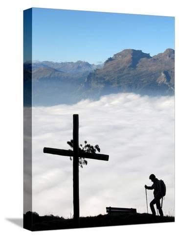 A Hiker Above Triesen in Liechtenstein Enjoys the View over the Sea of Fog-Arno Balzarini-Stretched Canvas Print