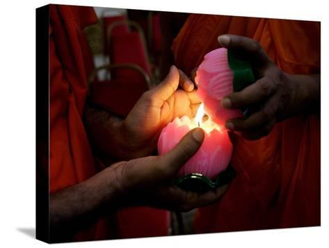 Buddhist Monks Light Candles During the Interfaith Special Prayers for Peace in Tibet-Shamshahrin Shamsudin-Stretched Canvas Print