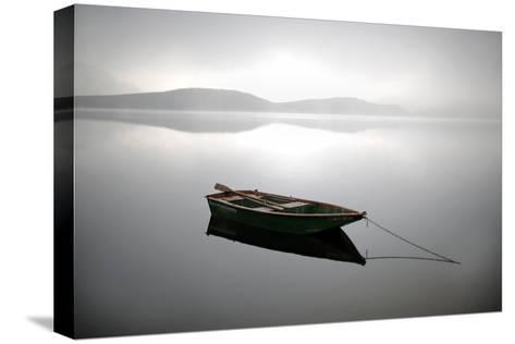 A Row Boat Floats on the Banks of Foggy Edersee Lake Near Waldeck, Central Germany-Uwe Zucchi-Stretched Canvas Print