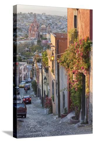 Mexico, San Miguel de Allende. Street scene with overview of city.-Don Paulson-Stretched Canvas Print