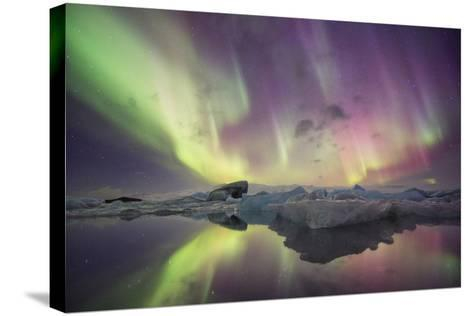 Iceland, Jokulsarlon. Aurora lights reflect in lagoon.-Josh Anon-Stretched Canvas Print