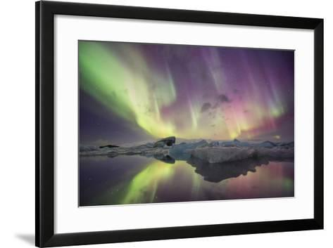 Iceland, Jokulsarlon. Aurora lights reflect in lagoon.-Josh Anon-Framed Art Print