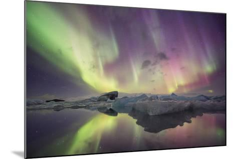 Iceland, Jokulsarlon. Aurora lights reflect in lagoon.-Josh Anon-Mounted Photographic Print