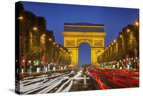 Twilight along Champs Elysee with Arc de Triomphe, Paris, France.-Brian Jannsen-Stretched Canvas Print