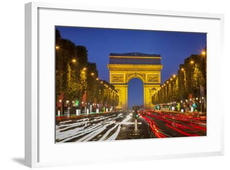 Twilight along Champs Elysee with Arc de Triomphe, Paris, France.-Brian Jannsen-Framed Art Print
