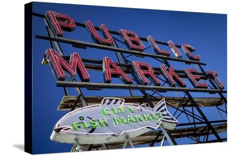 Pike Place Market sign near the waterfront, Seattle, Washington, USA-Brian Jannsen-Stretched Canvas Print