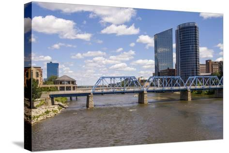 Pedestrian bridge and downtown skyline, Grand Rapids, Michigan, USA-Randa Bishop-Stretched Canvas Print